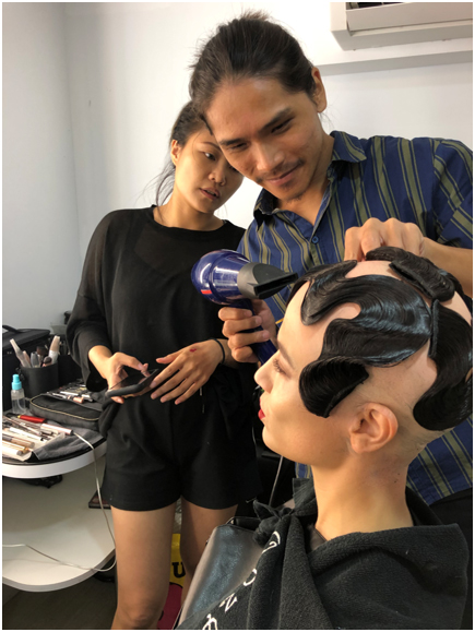 Esther and Brett working on hair